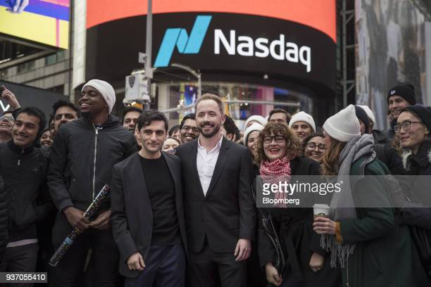 Drew Houston chief executive officer and cofounder of Dropbox Inc center right and Arash Ferdowsi cofounder of Dropbox Inc center left stand for a...