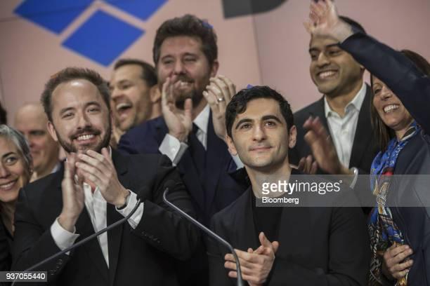 Drew Houston chief executive officer and cofounder of Dropbox Inc left and Arash Ferdowsi cofounder of Dropbox Inc applaud during the company's...