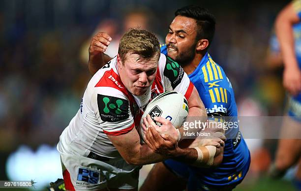 Drew Hutchinson of the Dragons heads for the try line to score during the round 25 NRL match between the Parramatta Eels and the St George Illawarra...