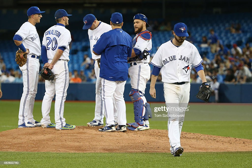 Drew Hutchison #36 of the Toronto Blue Jays exits the game as he is relieved by manager John Gibbons #5 in the sixth inning during MLB game action against the Kansas City Royals on July 31, 2015 at Rogers Centre in Toronto, Ontario, Canada.
