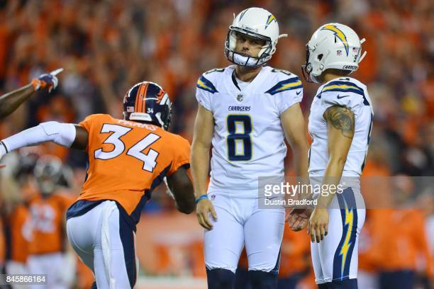 Drew Kaser and kicker Younghoe Koo of the Los Angeles Chargers react to missing a gametying field goal in the fourth quarter of the game against the...