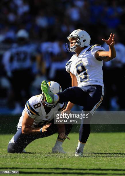 Drew Kaser holds while Younghoe Koo of the Los Angeles Chargers kicks an extra point during the second half of a game against the Philadelphia Eagles...