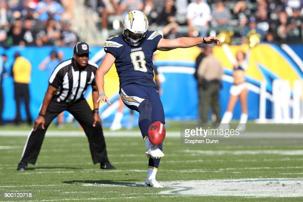 Drew Kaser of the Los Angeles Chargers punts during the first half of the game against the Oakland Raiders at StubHub Center on December 31 2017 in...