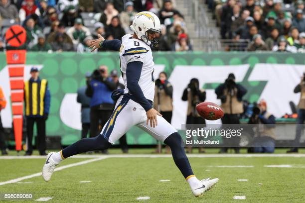 Drew Kaser of the Los Angeles Chargers punts the ball during the first half against the New York Jets in an NFL game at MetLife Stadium on December...