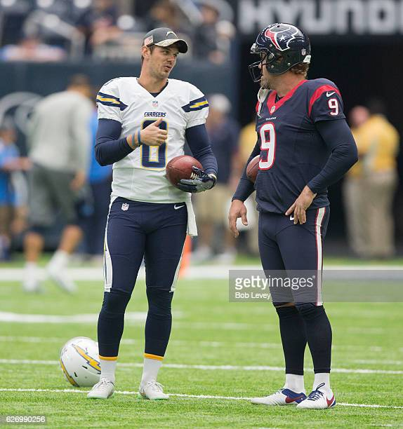 Drew Kaser of the San Diego Chargers and Shane Lechler of the Houston Texans chat before the game at NRG Stadium on November 27 2016 in Houston Texas...