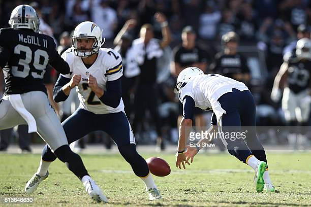 Drew Kaser of the San Diego Chargers dives after the ball after fumbling the snap on a field goal attempt in the fourth quarter against the Oakland...