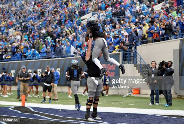Drew Kyser and Anthony Miller of the Memphis Tigers celebrate a touchdown against the SMU Mustangs on November 18 2017 at Liberty Bowl Memorial...