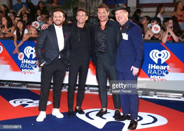 Drew Lachey Jeff Timmons Nick Lachey and Justin Jeffre of 98 Degrees arrive at the 2018 iHeartRADIO MuchMusic Video Awards at MuchMusic HQ on August...