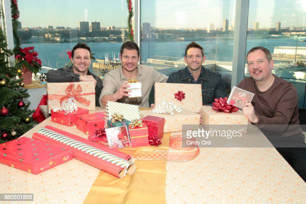 Drew Lachey Nick Lachey Jeff Timmons and Justin Jeffre of 98 Degrees and Mastercard get in the holiday spirit tapping Masterpass to purchase holiday...