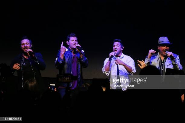 Drew Lachey Nick Lachey Jeff Timmons and Justin Jeffre of the group 98 Degrees perform during Under The Stars 2019 at Riverside Yacht Club on May 17...