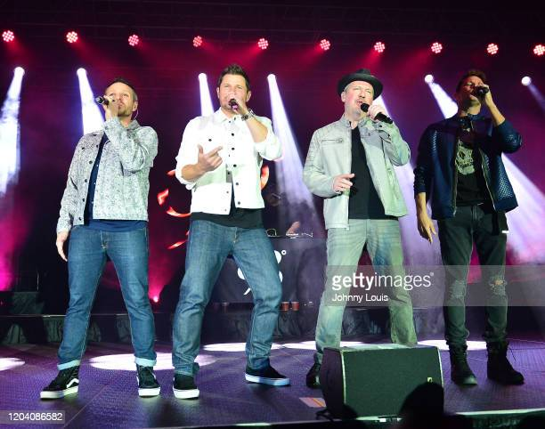 Drew Lachey, Nick Lachey, Justin Jeffre and Jeff Timmons of 98 Degrees perform on stage at Seminole Casino Coconut Creek on February 28, 2020 in...