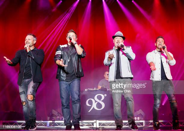Drew Lachey Nick Lachey Justin Jeffre Jeff Timmons of 98 Degrees perform on stage during Summer Night Concerts at PNE Amphitheatre on August 20 2019...
