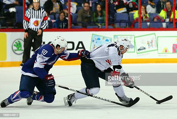Drew LeBlanc of USA and Antoine Roussel of France battle for the puck during the IIHF World Championship group H match between USA and France at...