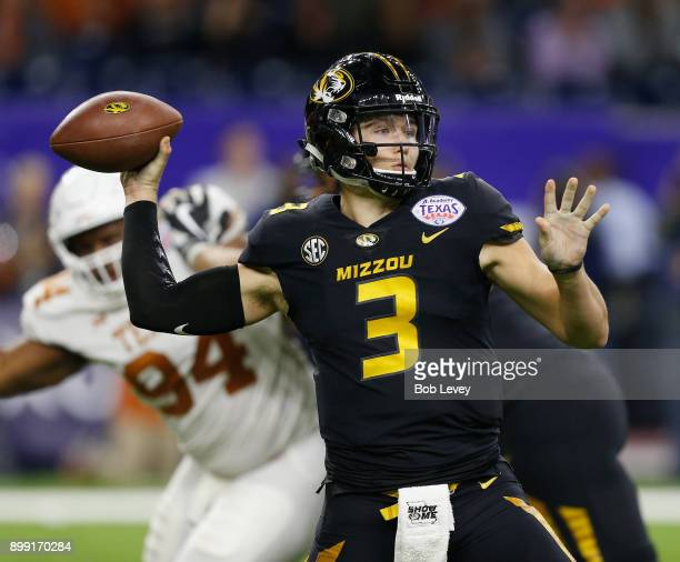 Drew Lock of the Missouri Tigers looks for a receiver against the Texas Longhorns during the Academy Sports Outdoors Bowl at NRG Stadium on December...