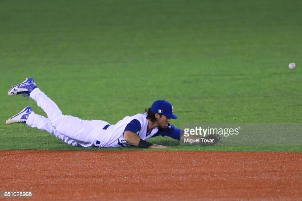 Drew Maggi of Italy dives for a ball in the top of the eighth inning during the World Baseball Classic Pool D Game 1 between Italy and Mexico at...