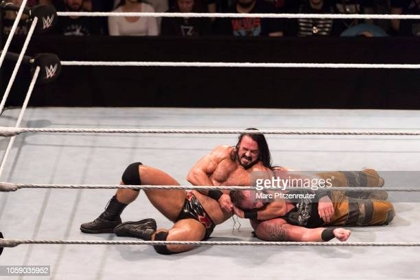 Drew McIntyre competes in the ring against Braun Strowman during the WWE Live Show at Lanxess Arena on November 7 2018 in Cologne Germany