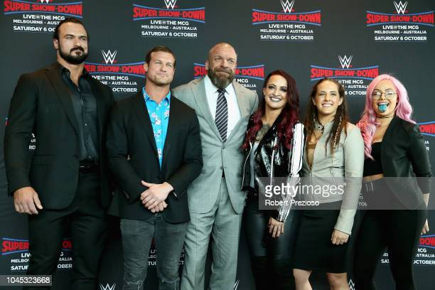 Drew McIntyre Dolph Ziggler Triple H and Riott Squad pose for photos during a WWE Downunder media opportunity at Crown Entertainment Complex on...