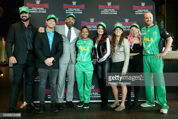 Drew McIntyre Dolph ZigglerTriple H and Riott Squad pose for photos with Melbourne Stars players Alana King and Michael Beer during a WWE Downunder...