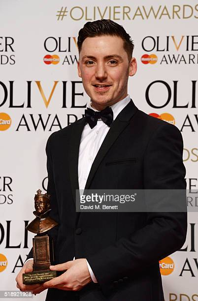 Drew McOnie winner of the Best Theatre Choreographer award for In The Heights poses in the Winners Room at The Olivier Awards with Mastercard at The...