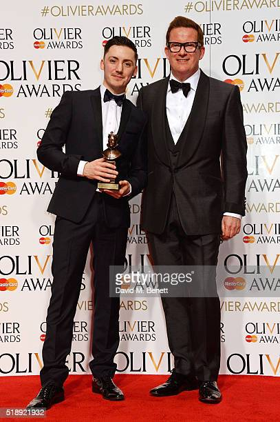 Drew McOnie winner of the Best Theatre Choreographer award for 'In The Heights' and presenter Sir Matthew Bourne pose in the Winners Room at The...
