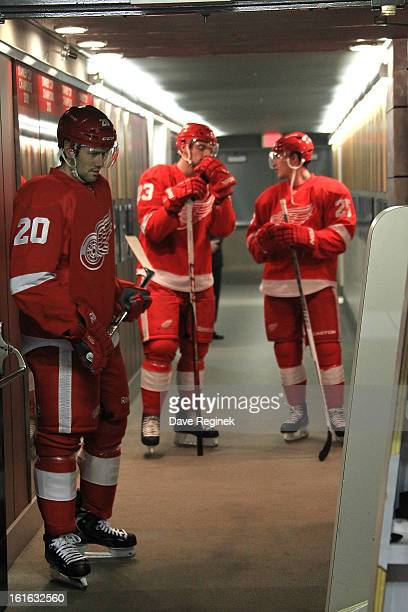 Drew Miller Brian Lashoff and Cory Emmerton of the Detroit Red Wings get ready to take the ice for warmups before a NHL game against the Calgary...