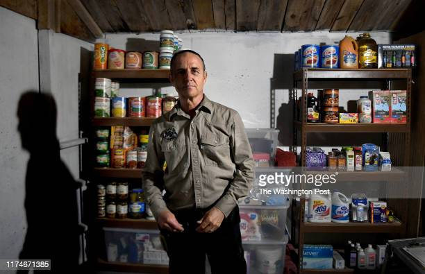 Drew Miller inside a wellstocked fortified bunker that's still under construction on August 23 2019 Miller a retired Air Force intelligence officer...