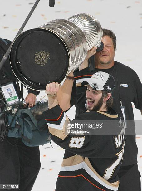 Drew Miller of the Anaheim Ducks hoists the Stanley Cup after his team's victory over the Ottawa Senators during Game Five on June 6 2007 at Honda...