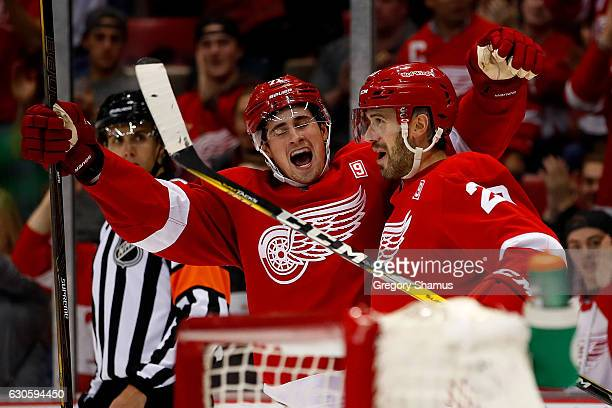 Drew Miller of the Detroit Red Wings celebrates a secondperiod goal with teammate Dylan Larkin while playing the Buffalo Sabres at Joe Louis Arena on...