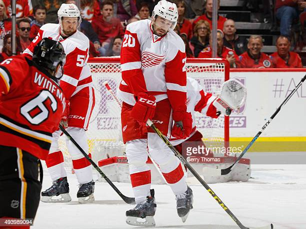 Drew Miller of the Detroit Red Wings tries to block a shot against the Calgary Flames at Scotiabank Saddledome on October 23 2015 in Calgary Alberta...