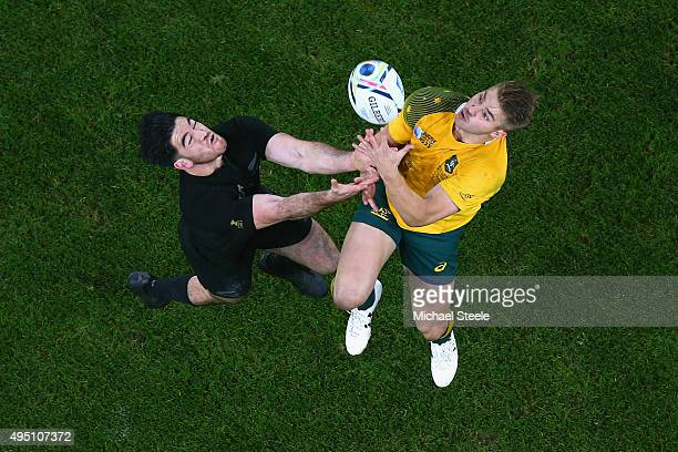 Drew Mitchell of Australia claims the high ball under pressure from Nehe MilnerSkudder of the New Zealand All Blacks during the 2015 Rugby World Cup...
