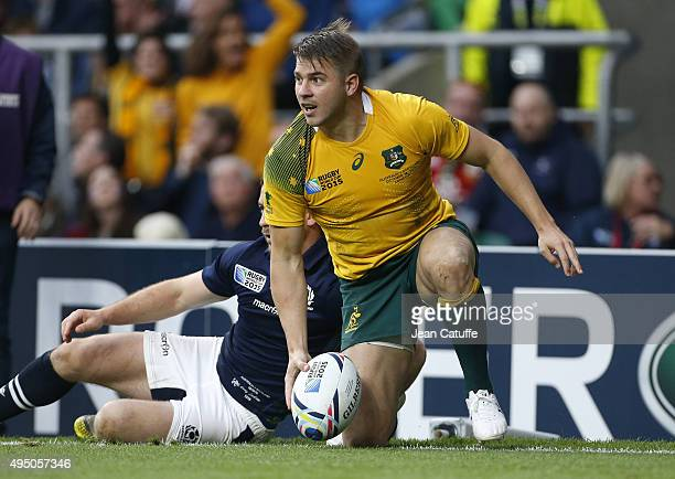 Drew Mitchell of Australia scores a try during the Rugby World Cup 2015 match between Australia and Scotland at Twickenham Stadium on October 18 2015...