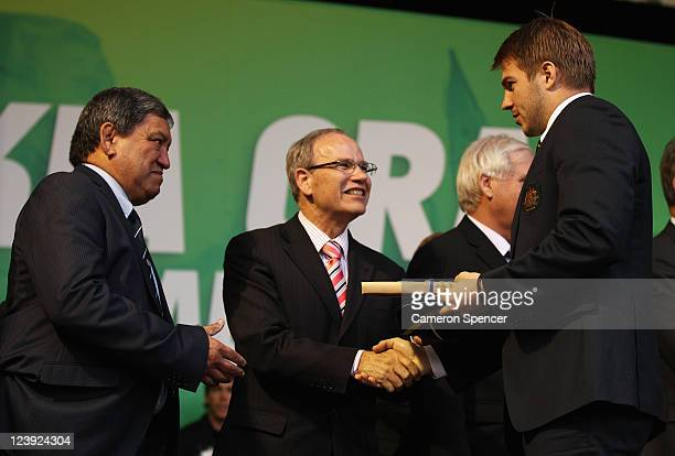 Drew Mitchell of the Wallabies receives his Rugby World Cup cap from Mayor of Auckland Len Brown and Kaumatua Matt Maihi during the Australian...