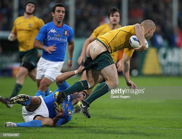 Drew Mitchell the Wallaby wing has his shorts pulled down by Edoardo Gori during the Test match between Italy and the Australian Wallabies at Stadio...