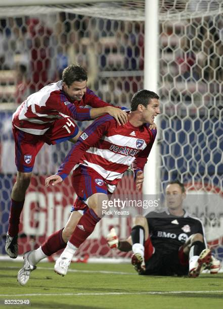 Drew Moor and Kenny Cooper of the FC Dallas celebrate a goal scored by Cooper against Greg Sutton goal keeper for the FC Toronto on October 11 2008...