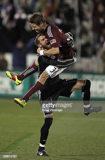 Drew Moor jumps into the arms of goalkeeper Matt Pickens of the Colorado Rapids as they celebrate their victory over the San Jose Earthquakes in the...