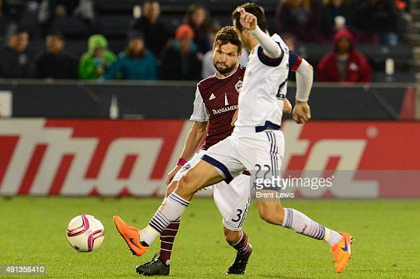 Drew Moor of Colorado Rapids tries to go for a steal on Juan Manuel Martinez of Real Salt Lake during the second half October 4 2015 at Dick's...