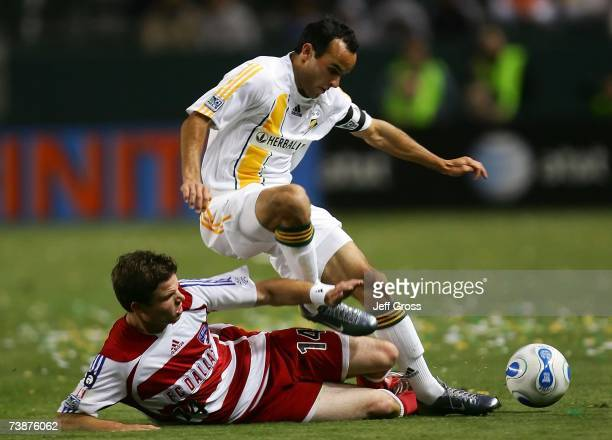 Drew Moor of FC Dallas tackles Landon Donovan of the Los Angeles Galaxy during their MLS match at Home Depot Center on April 12 2007 in Carson...