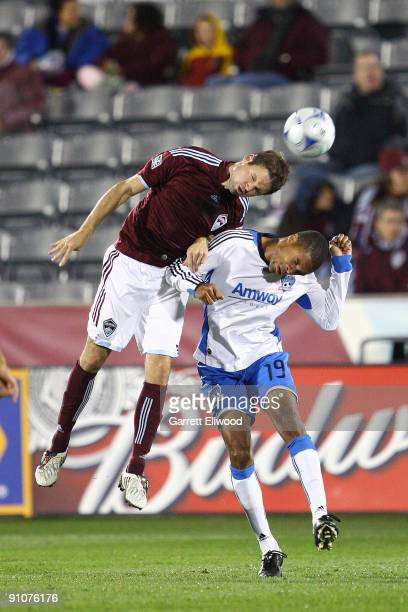 Drew Moor of the Colorado Rapids fights for the ball against Ryan Johnson of the San Jose Earthquakes on September 23, 2009 at Dick's Sporting Goods...
