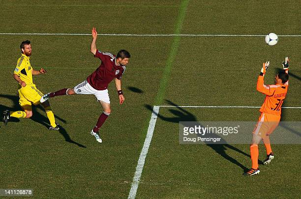 Drew Moor of the Colorado Rapids heads the ball past goalkeeper Andy Gruenebaum of the Columbus Crew after beating Eddie Gaven of the Columbus Crew...