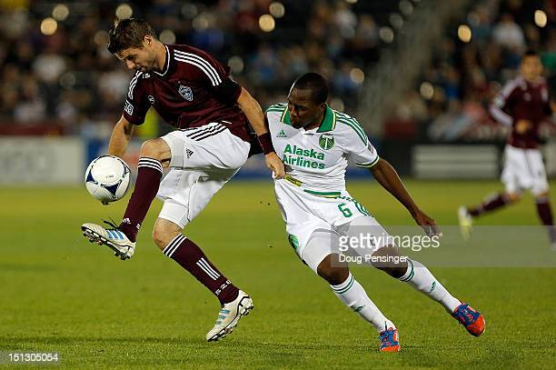 Drew Moor of the Colorado Rapids tries to control the ball as he is fouled by Darlington Nagbe of the Portland Timbers at Dick's Sporting Goods Park...