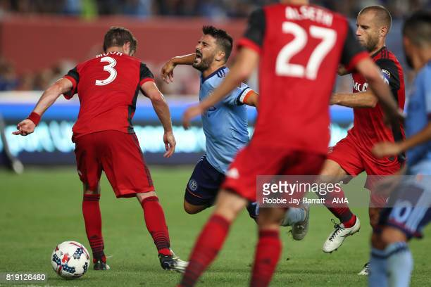 Drew Moor of Toronto FC and David Villa of New York City during MLS fixture between Toronto FC and New York City FC at Yankee Stadium on July 19 2017...