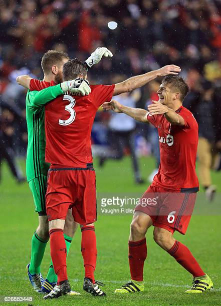 Drew Moor of Toronto FC celebrates with Clint Irwin and Nick Hagglund at the final whistle following the MLS Eastern Conference Final Leg 2 game...