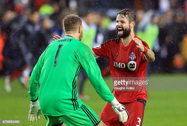 Drew Moor of Toronto FC celebrates with Clint Irwin at the final whistle following the MLS Eastern Conference Final Leg 2 game against Montreal...