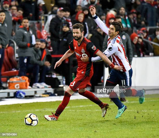 Drew Moor of Toronto FC controls the ball past Isac Brizuela of Chivas Guadalajara during the CONCACAF Champions League Final Leg 1 on April 17 2018...