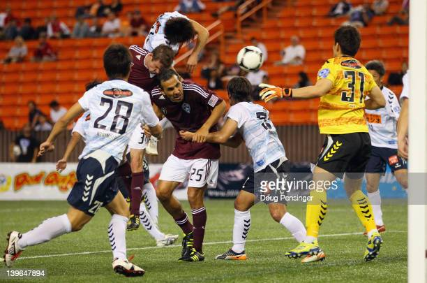 Drew Moore of the Colorado Rapids goes over the back of his teammate Pablo Mastreni as he heads in a goal in the 72nd minute against Yokohama FC...