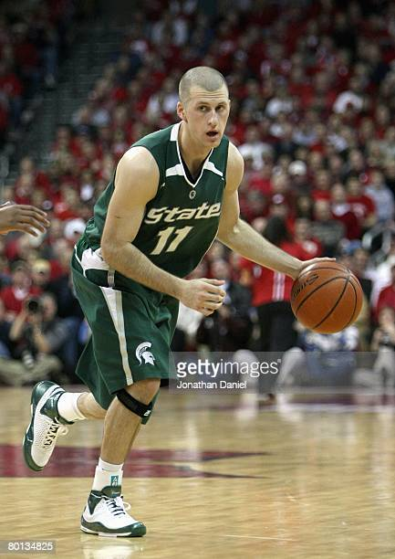 Drew Neitzel of the Michigan State Spartans drives against the Wisconsin Badgers during the game on February 28 2008 at the Kohl Center in Madison...