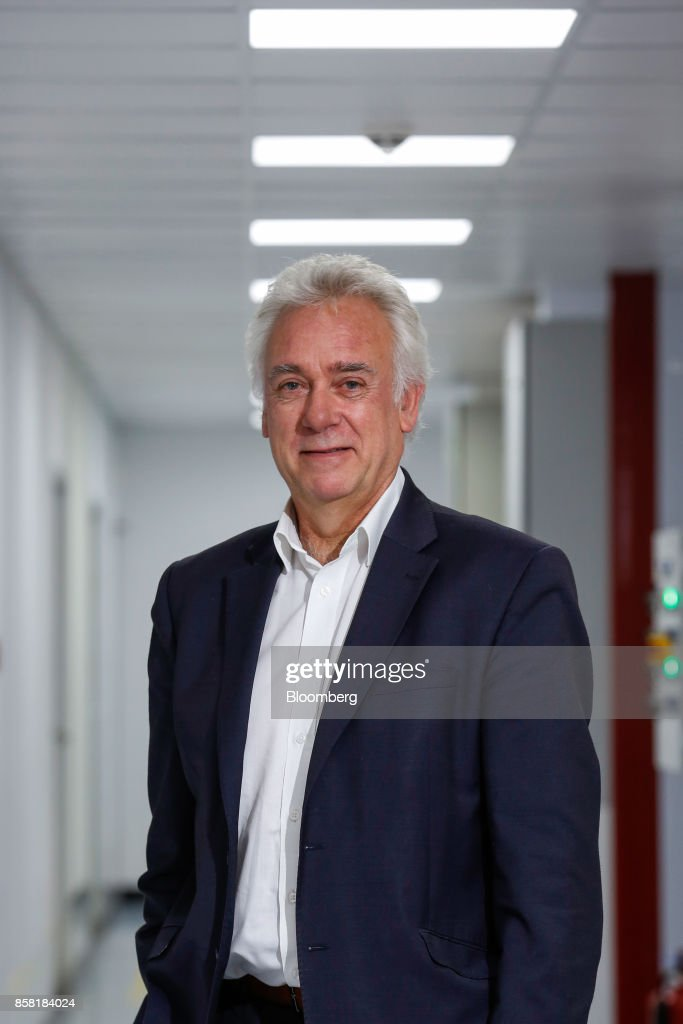 Drew Nelson, chief executive officer of IQE Plc, poses for a photograph at their headquarters in Cardiff, U.K., on Thursday, Sept. 28, 2017. IQE makes wafers that are needed for Vertical Cavity Surface Emitting Lasers (VCSELs), used for 3D sensors and widely thought to be included in the new iPhone. Photographer: Luke MacGregor/Bloomberg via Getty Images