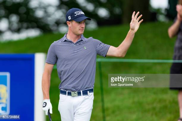 Drew Nesbitt acknowledges the cheering crowd at the tee on the 1st hole during second round action of the RBC Canadian Open on July 28 at Glen Abbey...