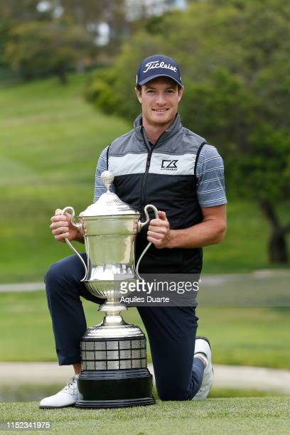 Drew Nesbitt of Canada holds the trophy after the final round of the PGA TOUR Latinoamerica 60º Abierto Mexicano de Golf at Club Campestre Tijuana on...