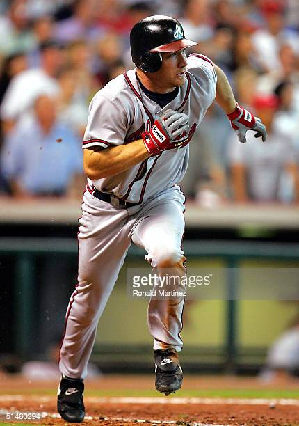D Drew of the Atlanta Braves hits a RBI single bringing in Rafael Furcal against the Houston Astros during game four of the National League Division...